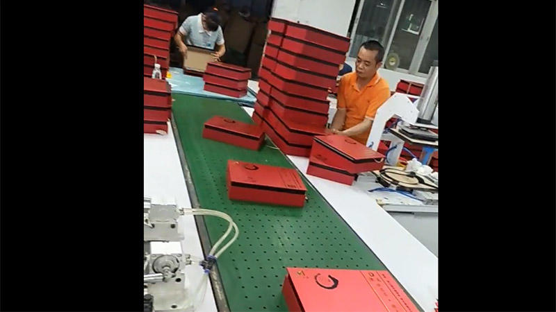 Red Paper Boxes are be Cleaning and then Packaging by Poly Bag and Cartons