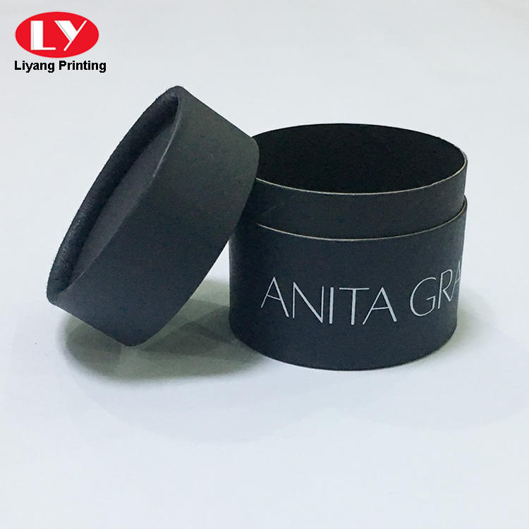 black tube box with lid